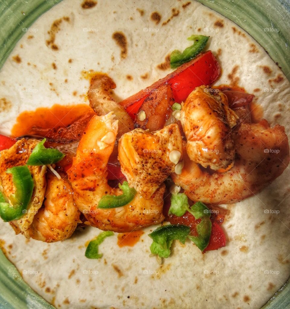 Shrimp and Chicken Fajitas with red peppers and jalapeños.
