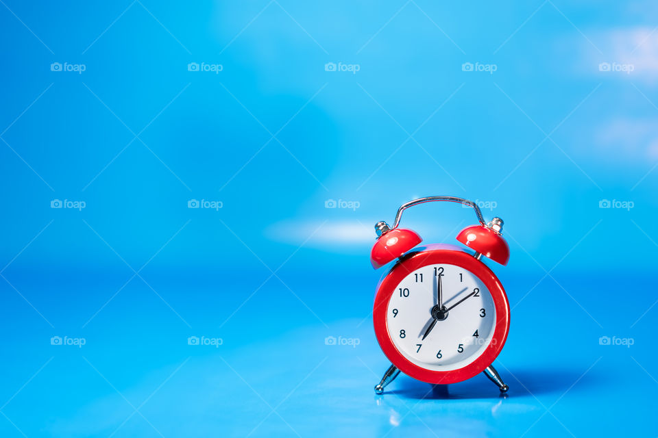 Red clock with blue background