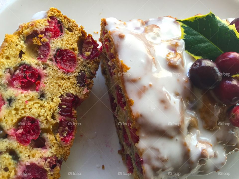 Cranberry loaf cake with icing and holly