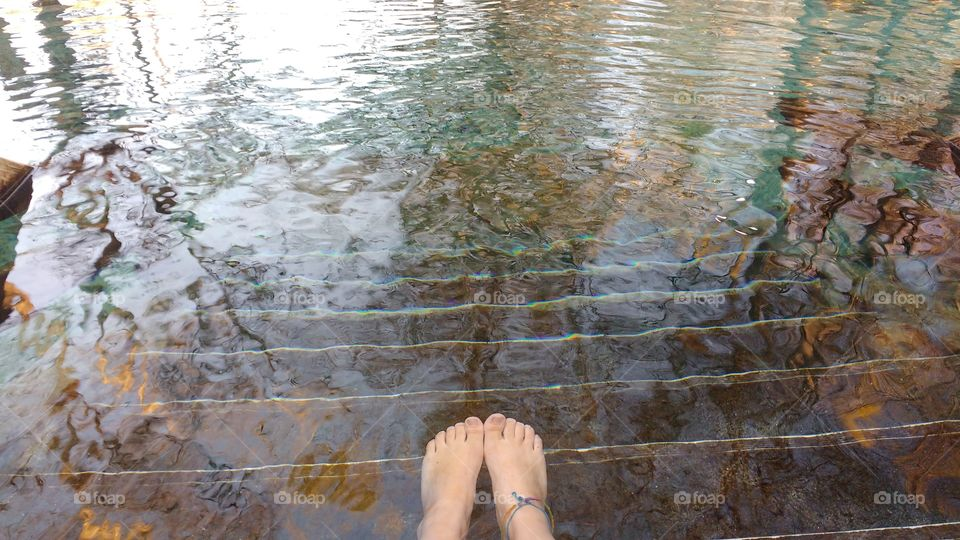 feet under the clear water of Ginnie Springs, Florida