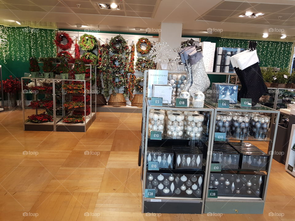 Christmas shop decorations stockongs baubles at Peter Jones Sloane square Chelsea King's road London