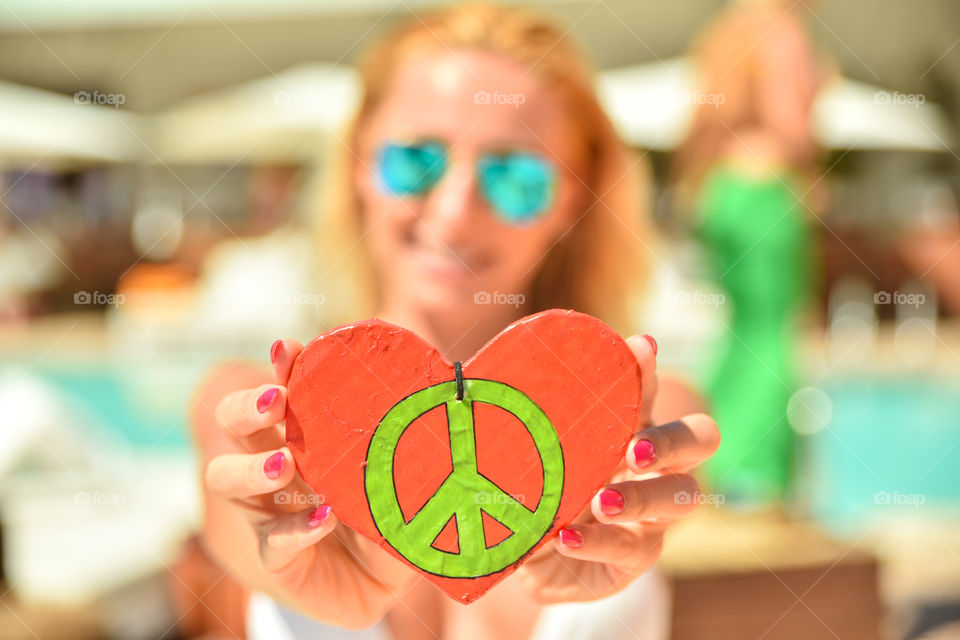 Woman showing peace and love sign