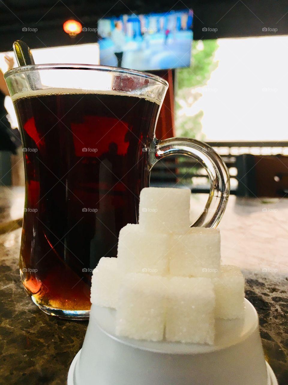 Pyramid of sugar cubes and Turkish tea