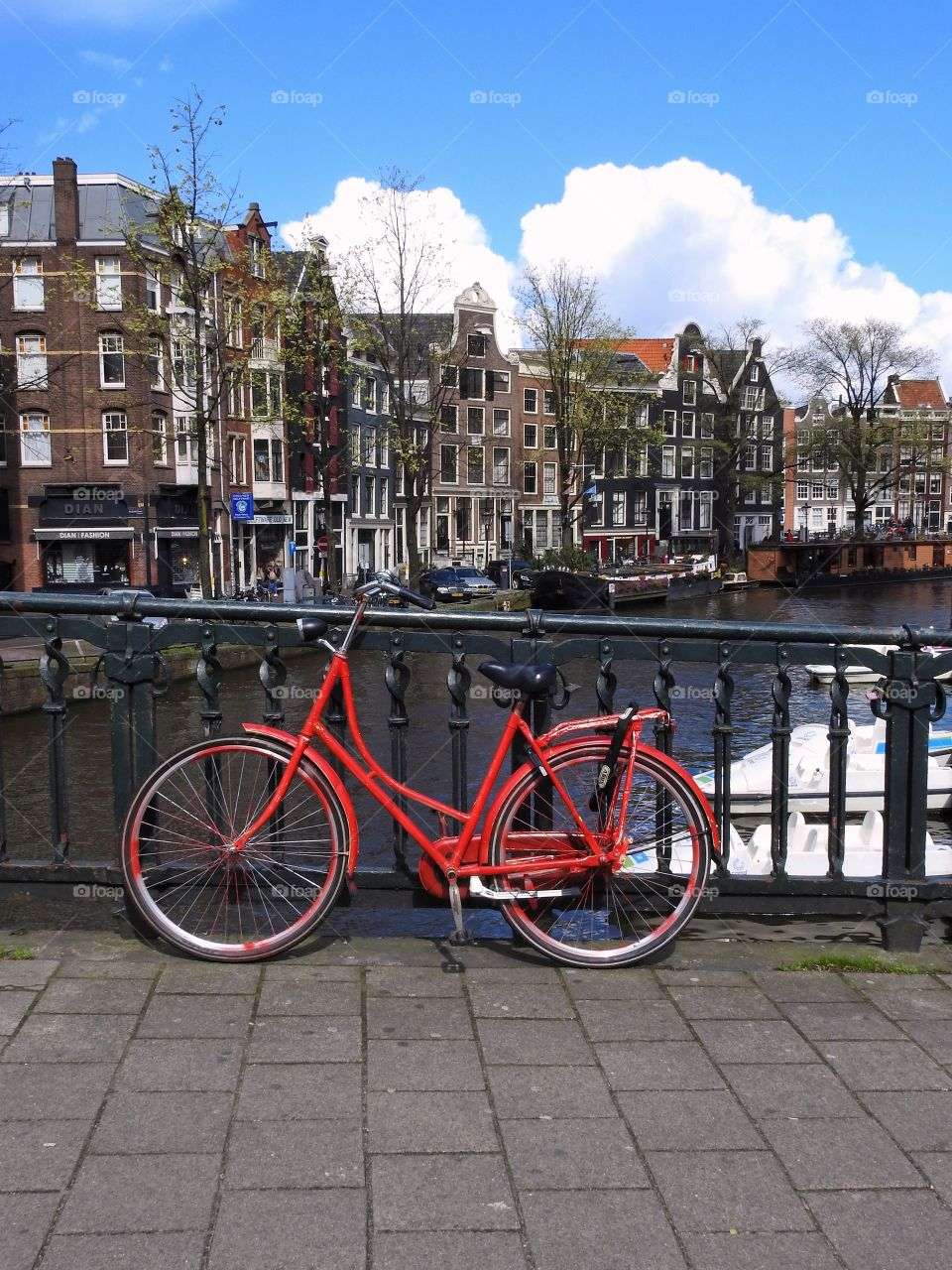 Red bike by a canal in Amsterdam