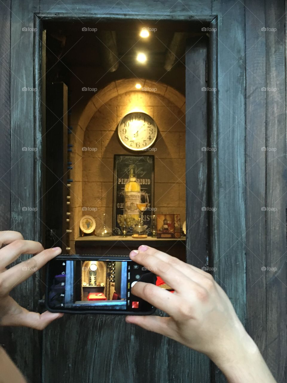Taking a photo of someone taking a photo of an elegant wine room