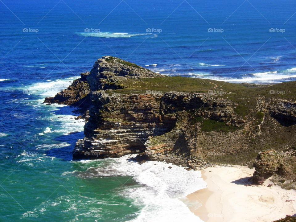 cliff , windy beach and blue ocean