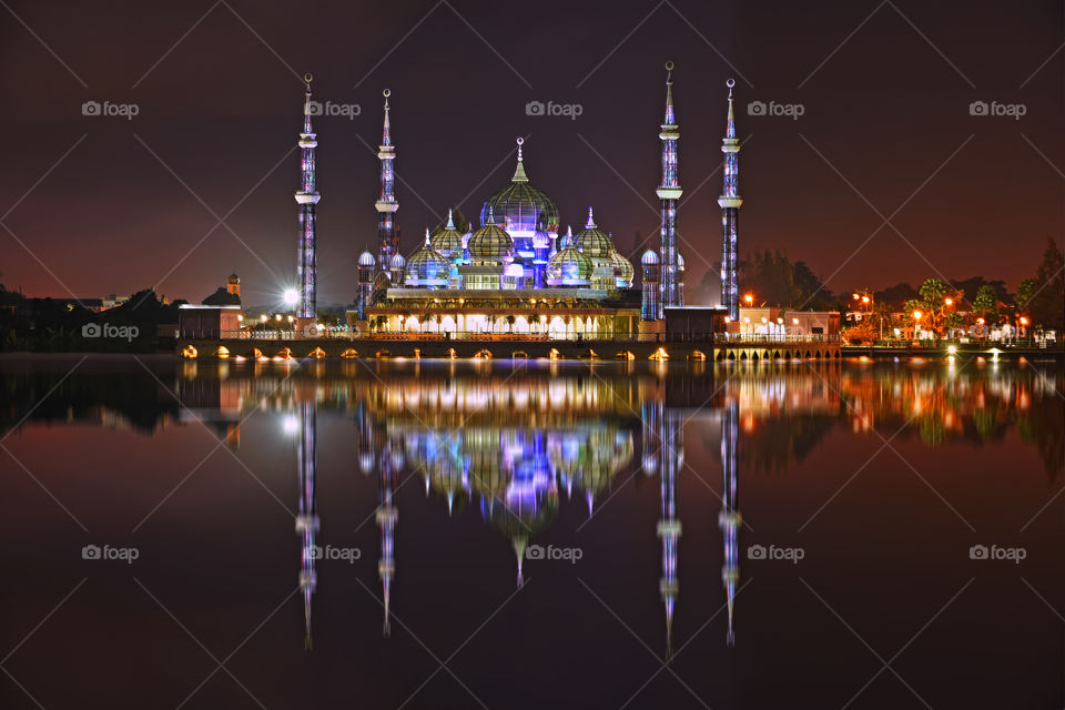 Beautiful reflections of Crystal Mosque at night