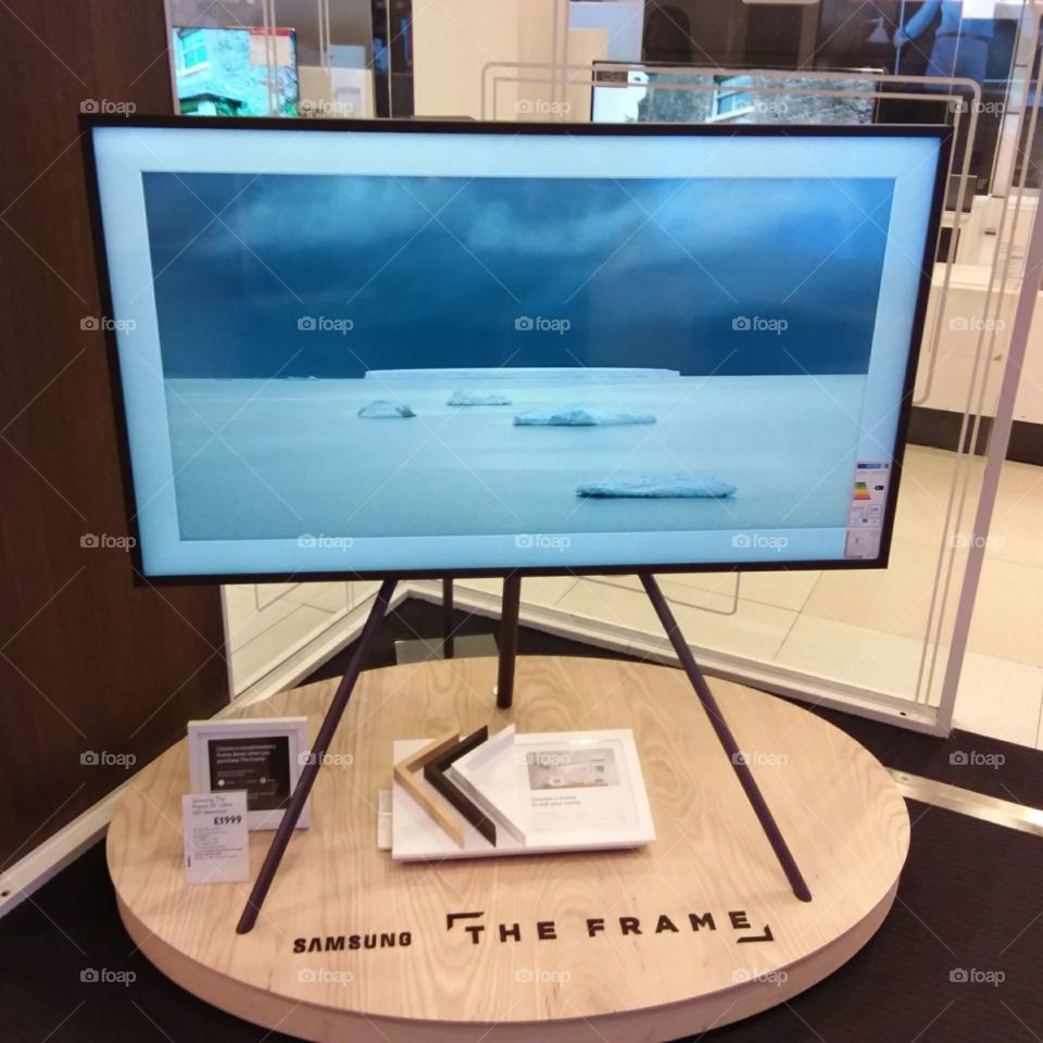 Samsung The Frame art mode television displaying a picture landscapes featuring bezels and mount
