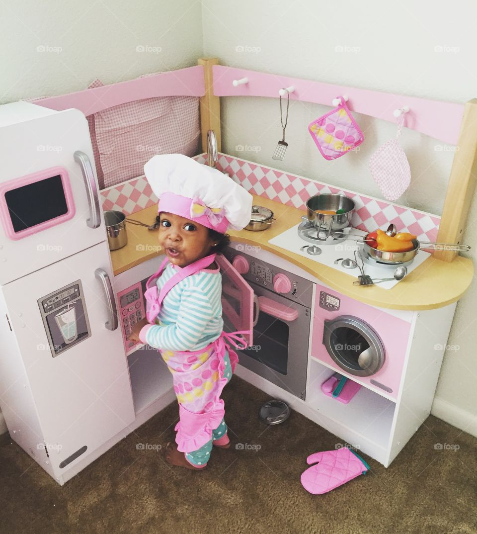 Elevated view of a girl standing in kitchen
