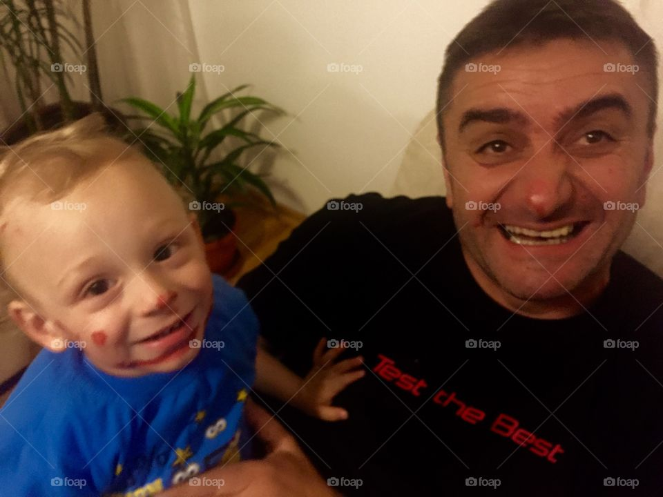 Messy face of a little boy with his father