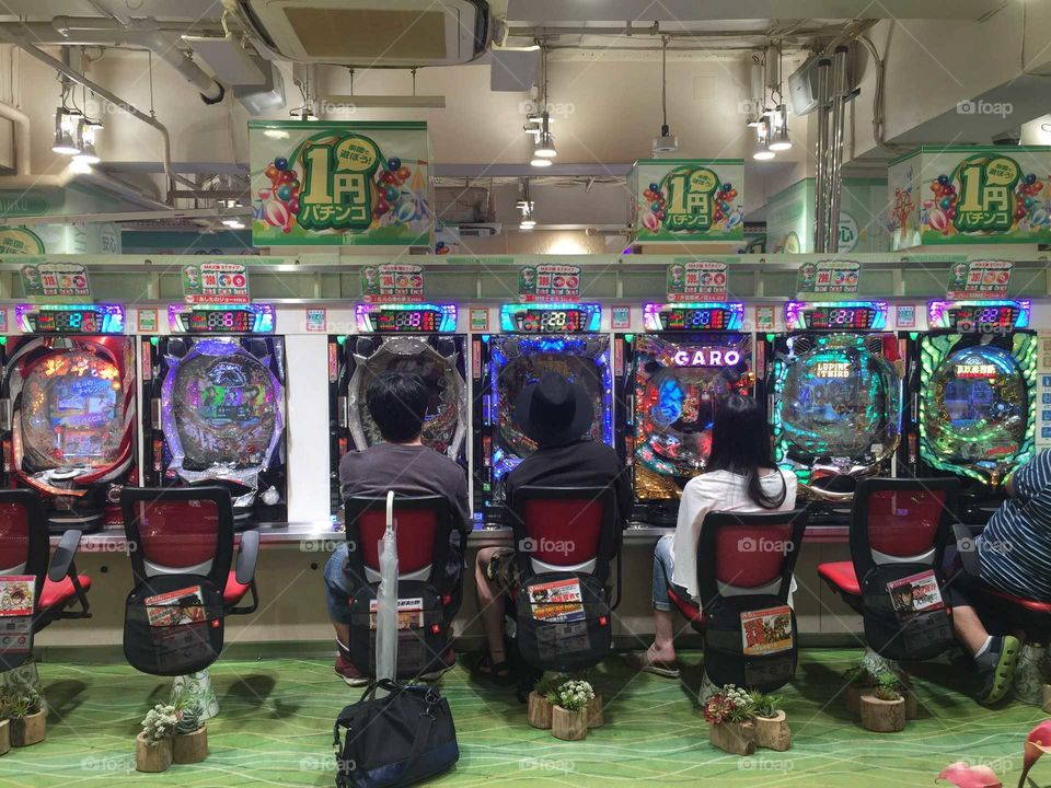 Japanease people playing pachinko in tokyo. Pachinko is a game that is an only legal form of gambling