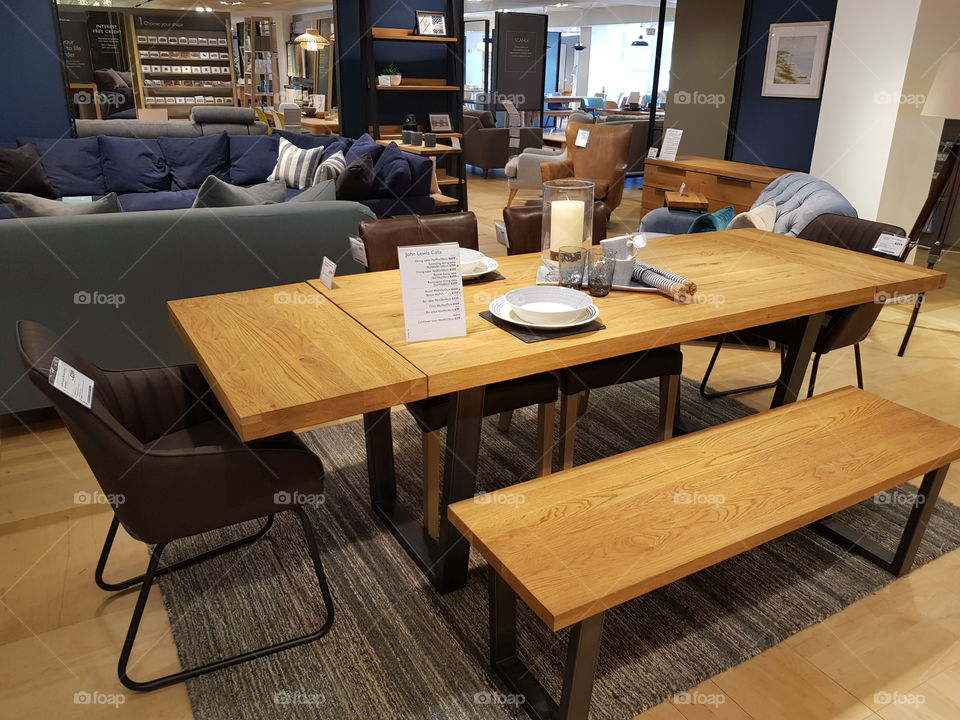 Wooden dining set with benches and rug at Peter Jones department store Sloane square Chelsea Kings road London