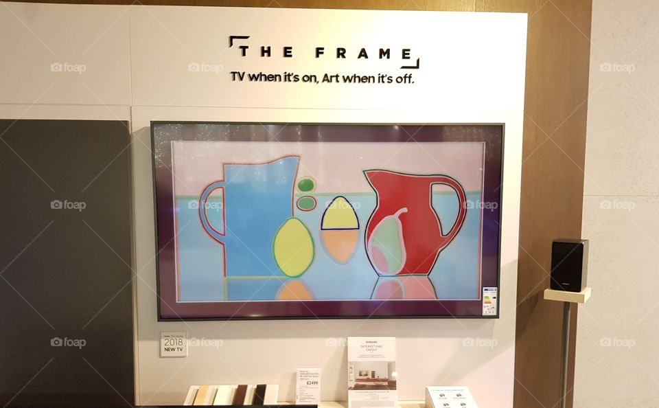 Samsung The Frame art mode 4K UHD TV installation wall mounted on no gap wall mount displaying customizable bezels at Peter Jones Sloane square Chelsea King's road London