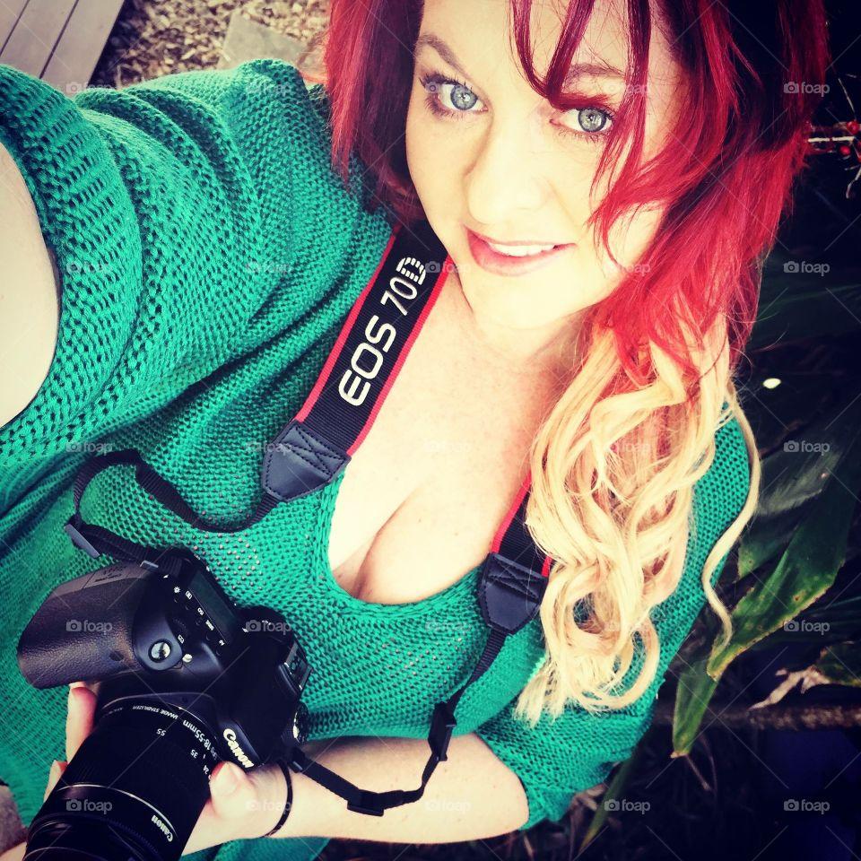 Beautiful woman holding professional camera
