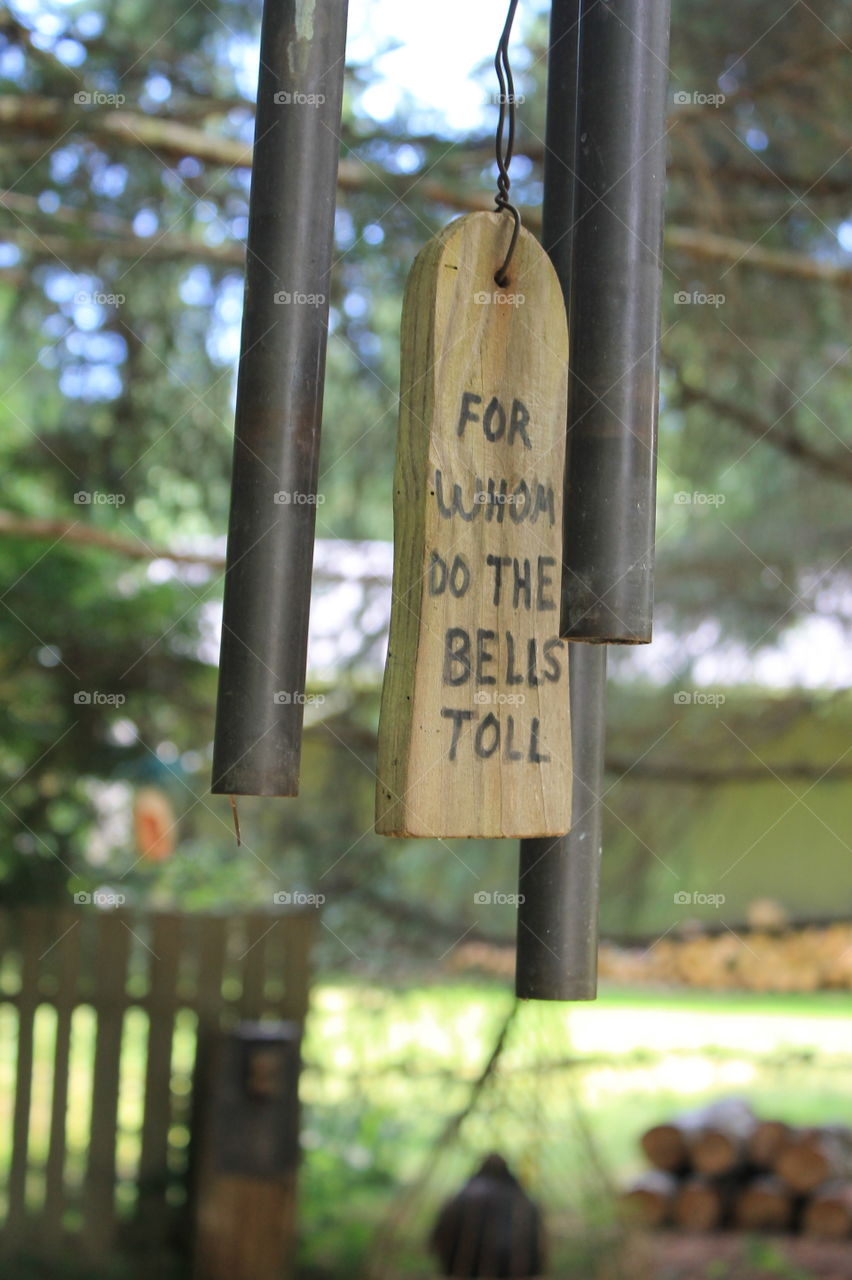 """At at the end of the trail through this unique West Coast park are some tubular bells that you are invited to ring. There is a wooden sign hanging between the bells with the words, """" For whom do the bells toll""""."""
