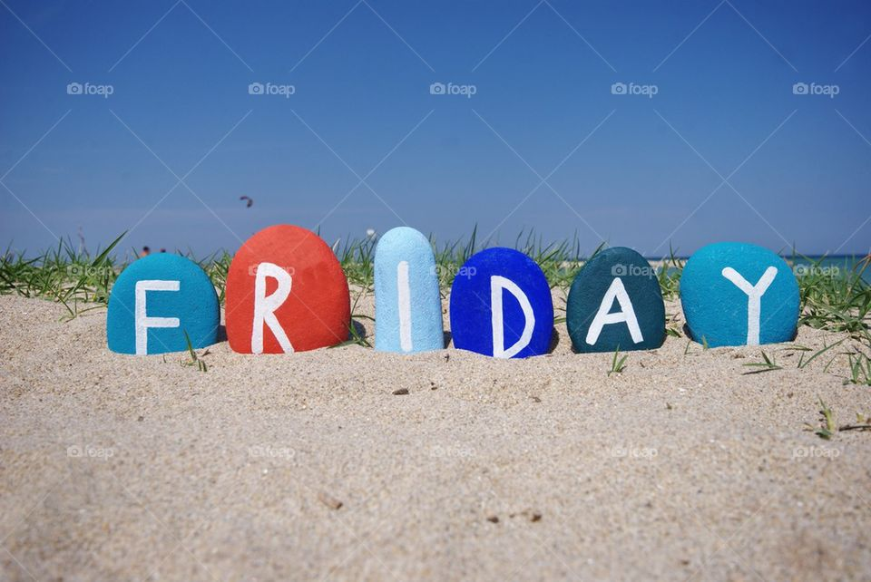 Friday, fifth day of the week on colourful stones