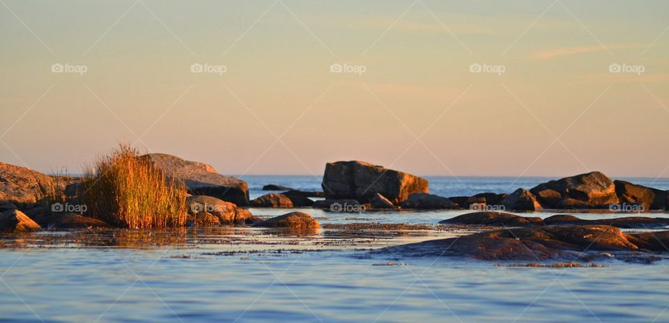 Tranquil sea at sunset