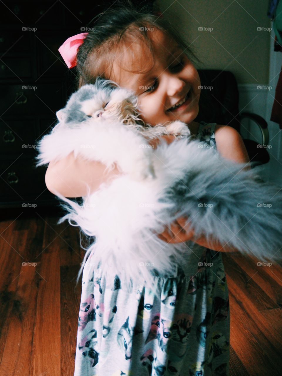 Portrait of a smiling girl with cat
