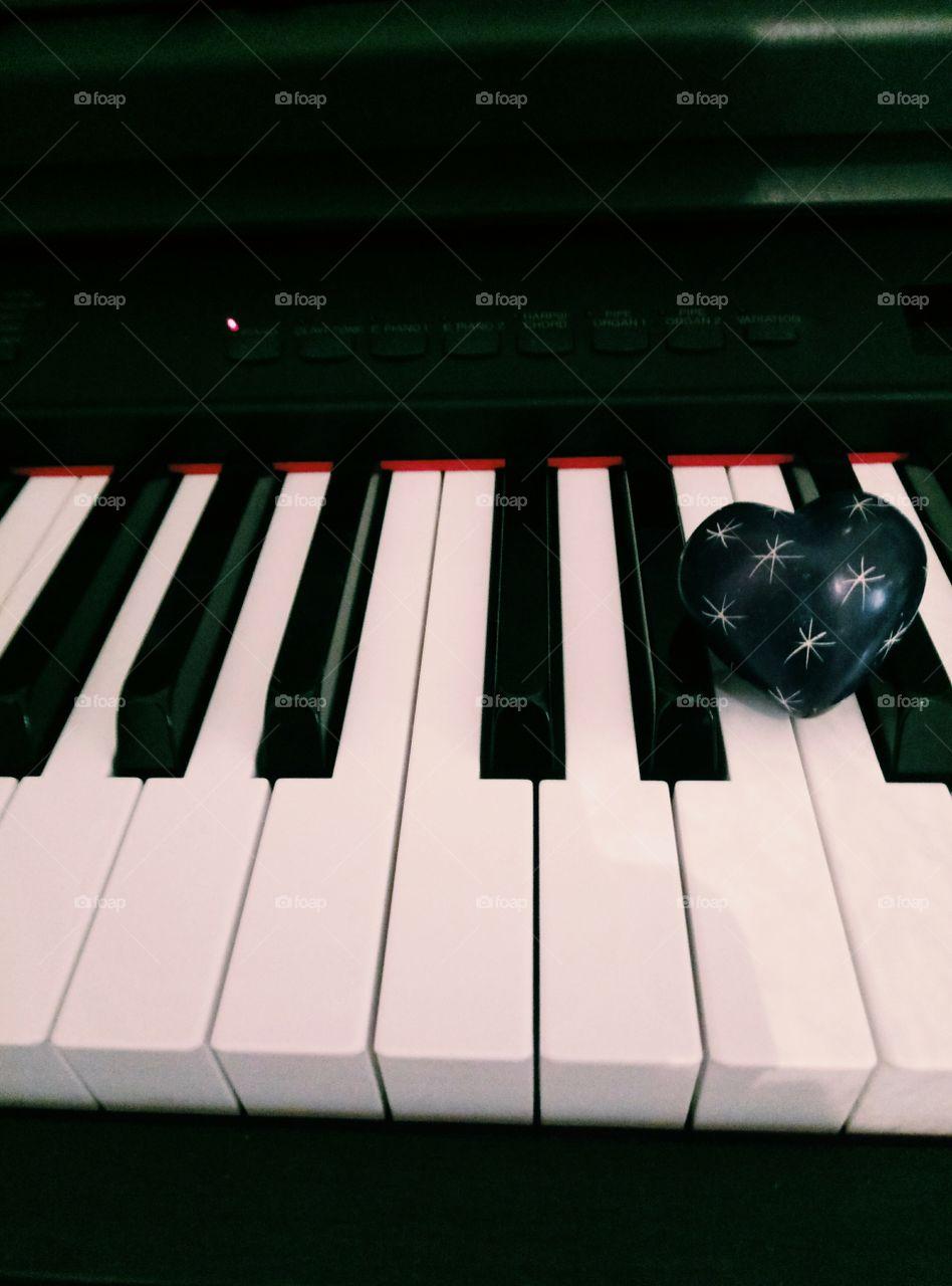 Blue heart on keys