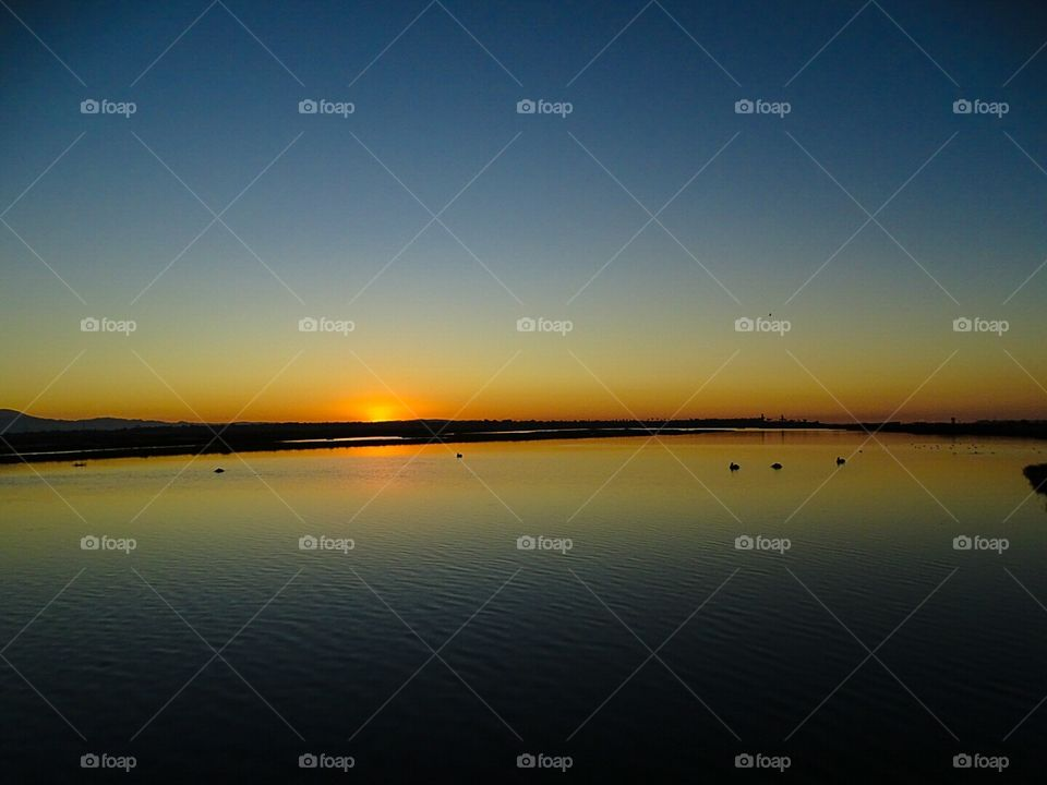Sunset over calm waters