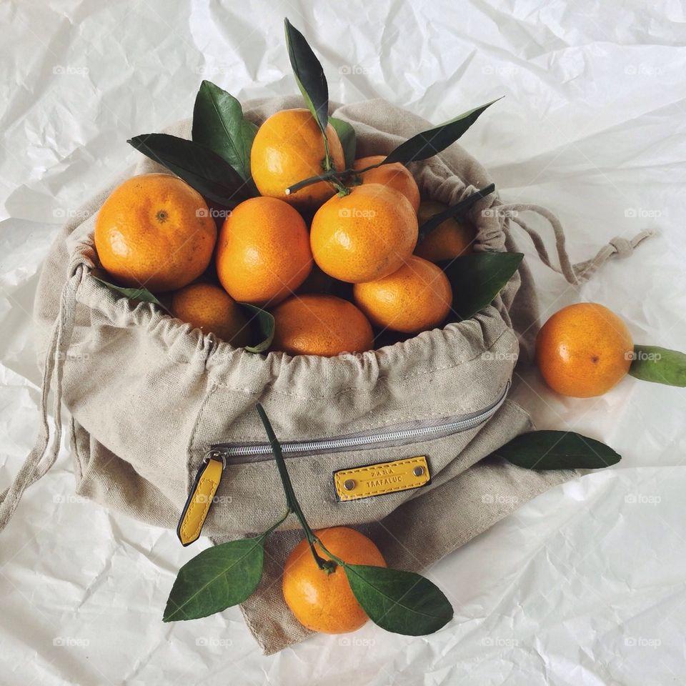 Fresh juicy oranges in bag