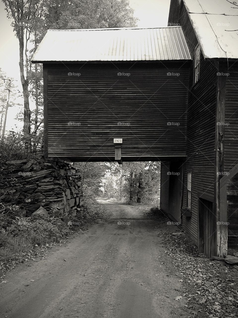 1903. Drive under the barn - black and white architecture mission