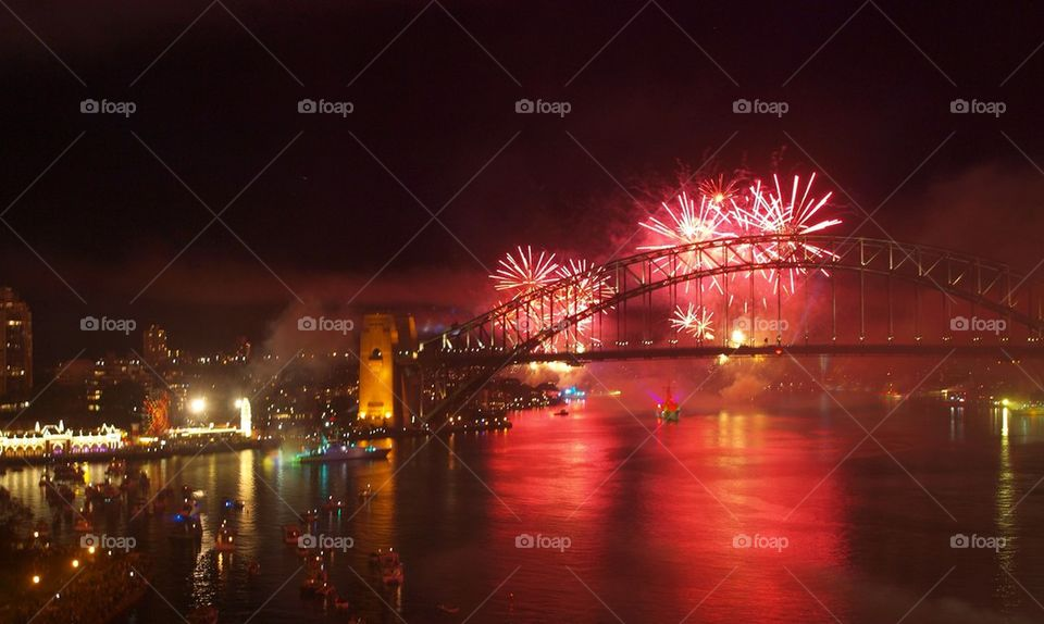 Sydney harbor bridge with fireworks at night