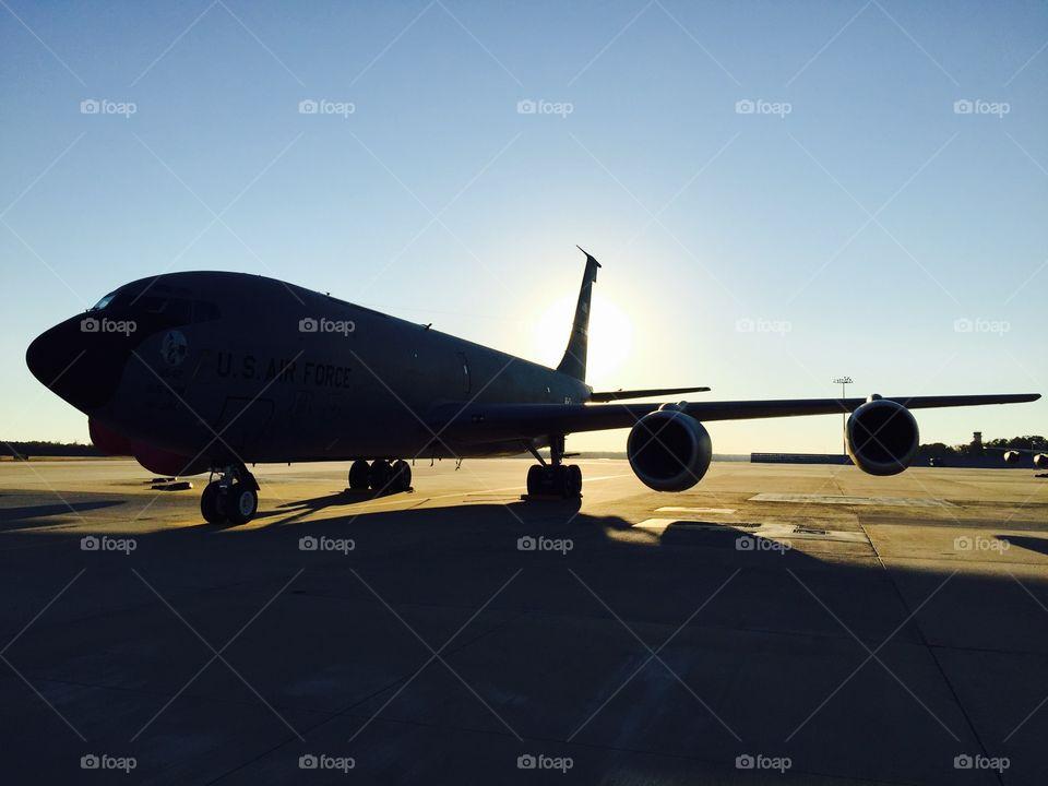 Sunset behind a KC-135 aircraft