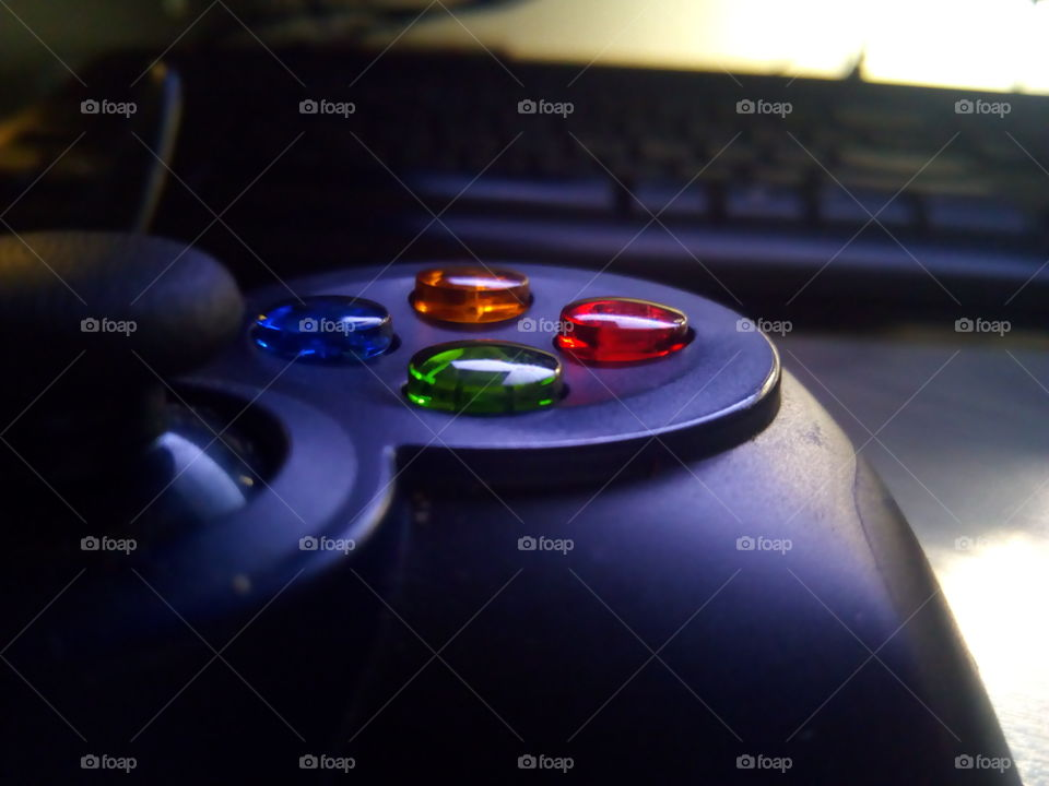 pc controller for gaming close up in front of a keyboard