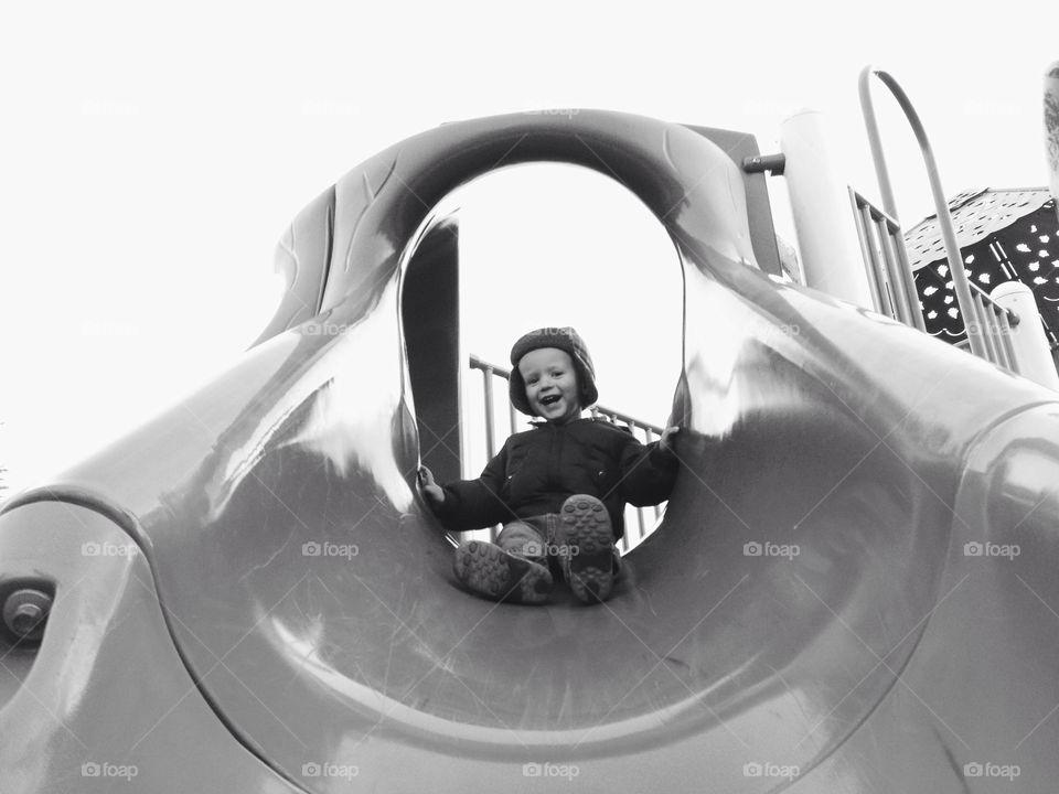 Little Boy Playing on Slide