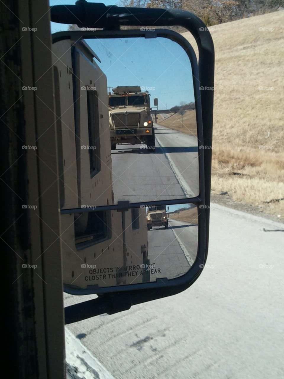 Military Hummer Reflection. mirror reflection of hummer humvee
