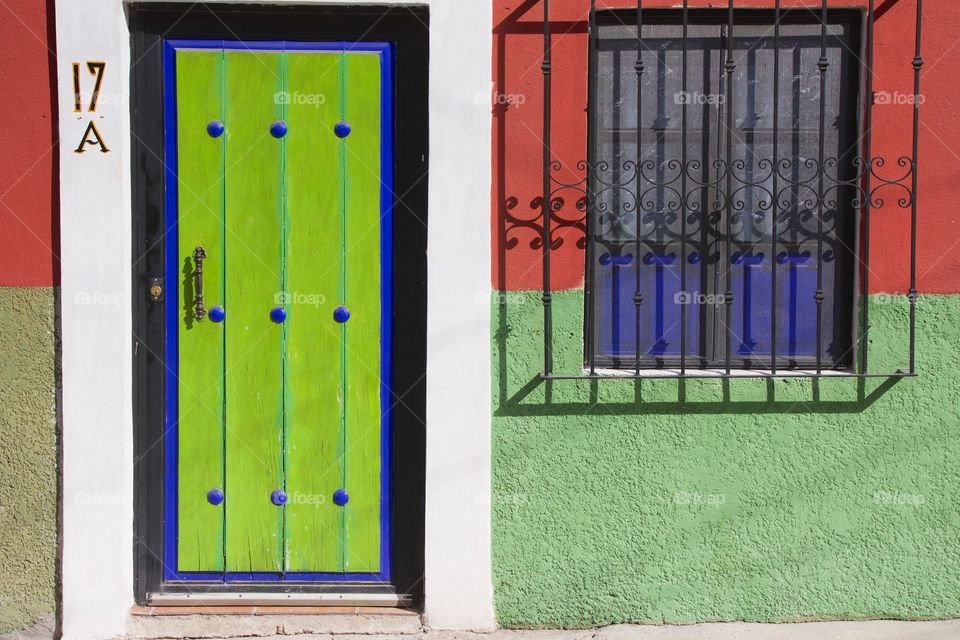 House with colorful window and door