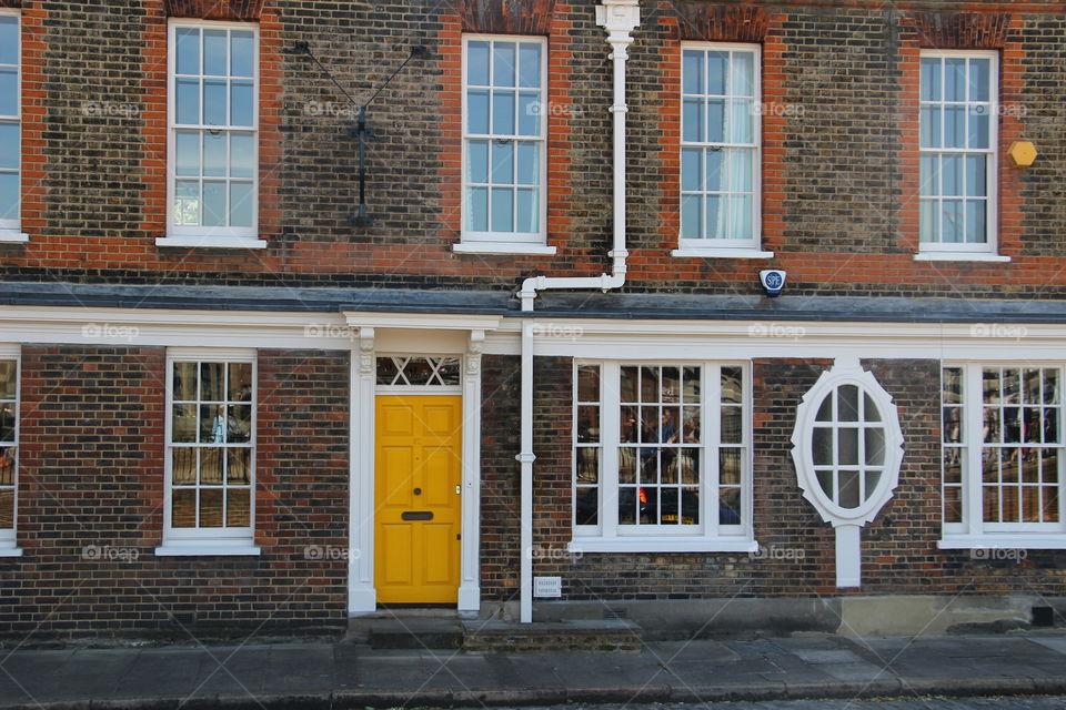 Building with yellow door