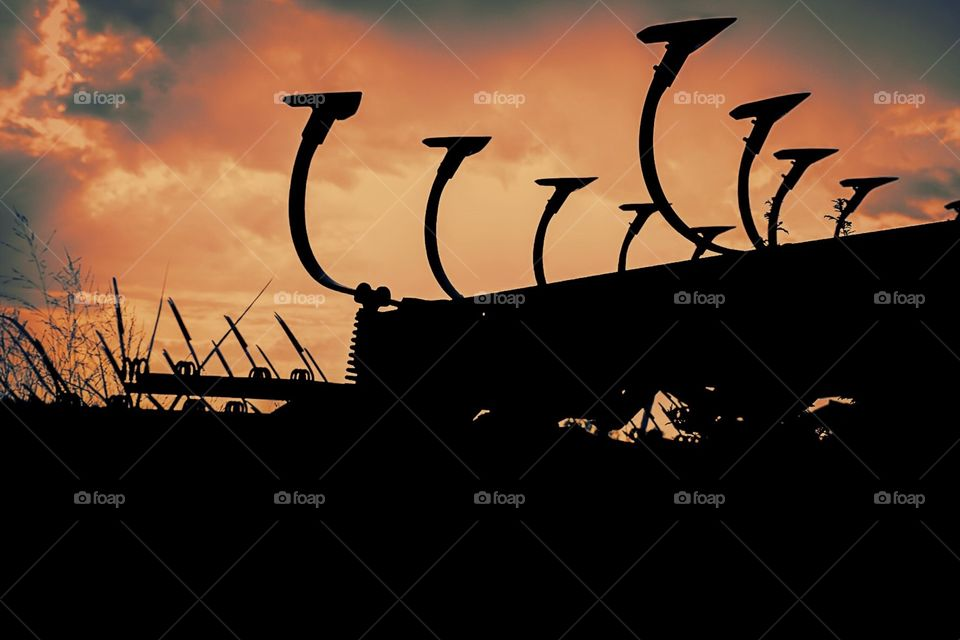 Silhouette Of Farm Equipment, Sunset On The Farm, Sunset In The Fields, Farming Equipment Backlit By The Sunshine, Silhouette In The Country, Farm Portrait