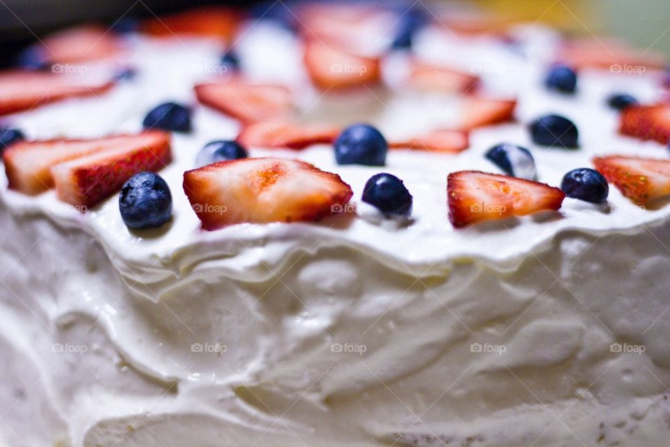 Close-up of cake with strawberries and blueberries