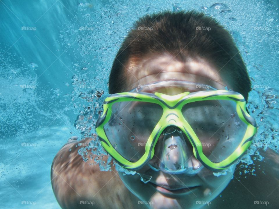 Close-up of a man swimming underwater