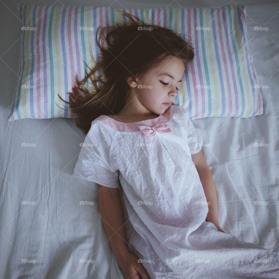 Sleeping. The moment before she woke...