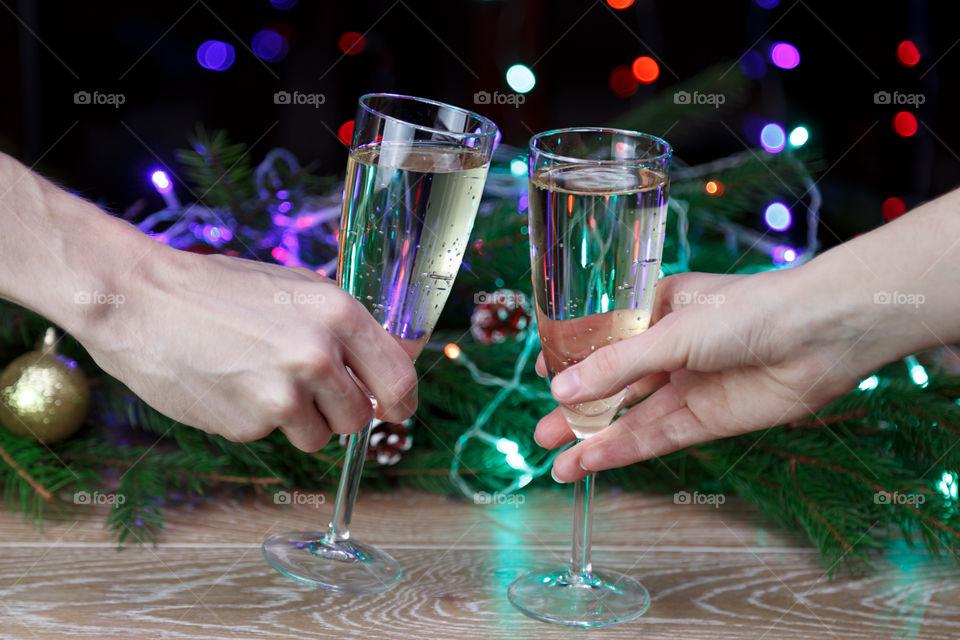 holding wine glasses