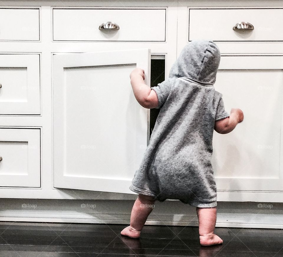 Rear view of child opening a door