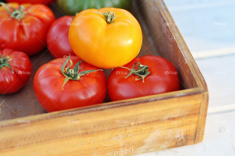 Tomatoes in wooden box