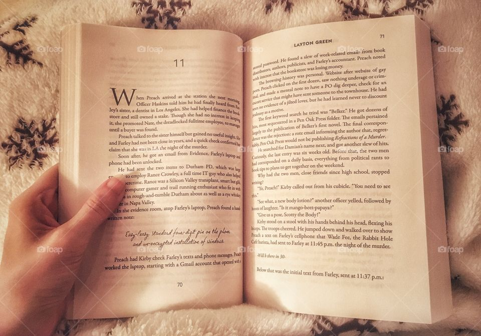 Snuggled up reading a book on a cold winters day