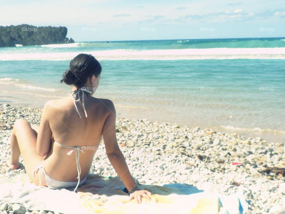 Beautiful young woman enjoying the beach in  Asturias, Spain