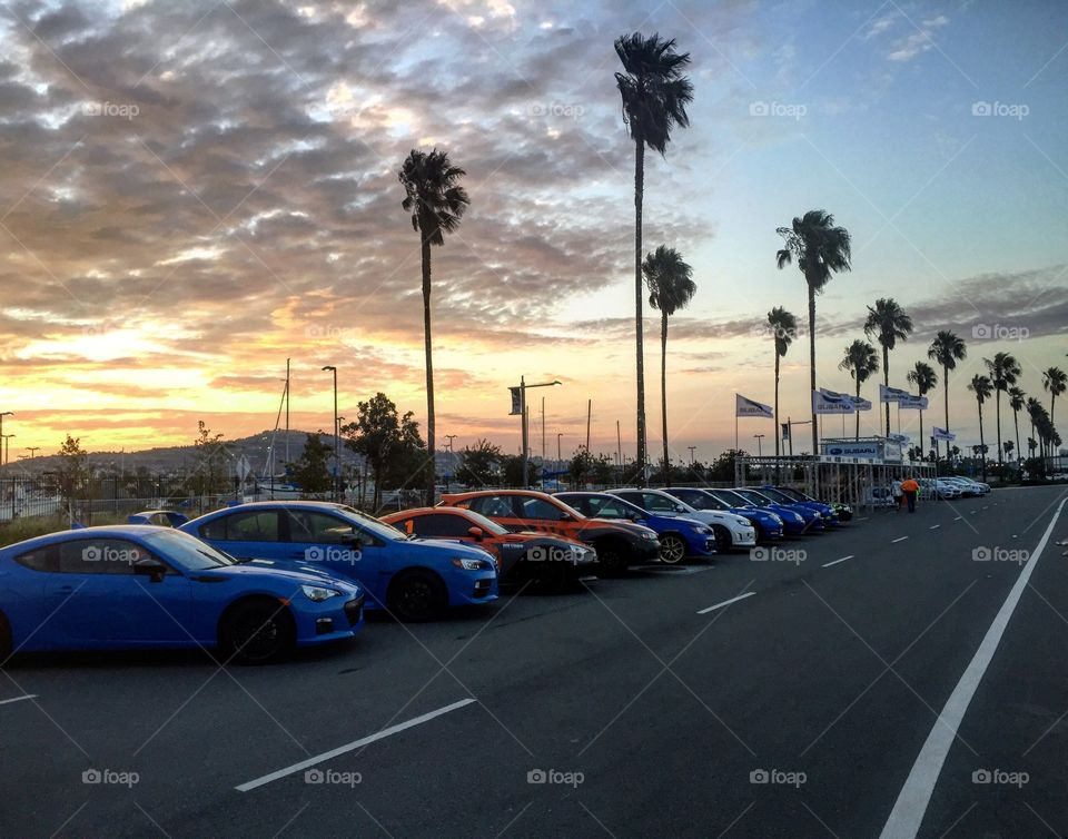 Subaru sunset. Subarus lined up at the port of Los Angeles day before the race.