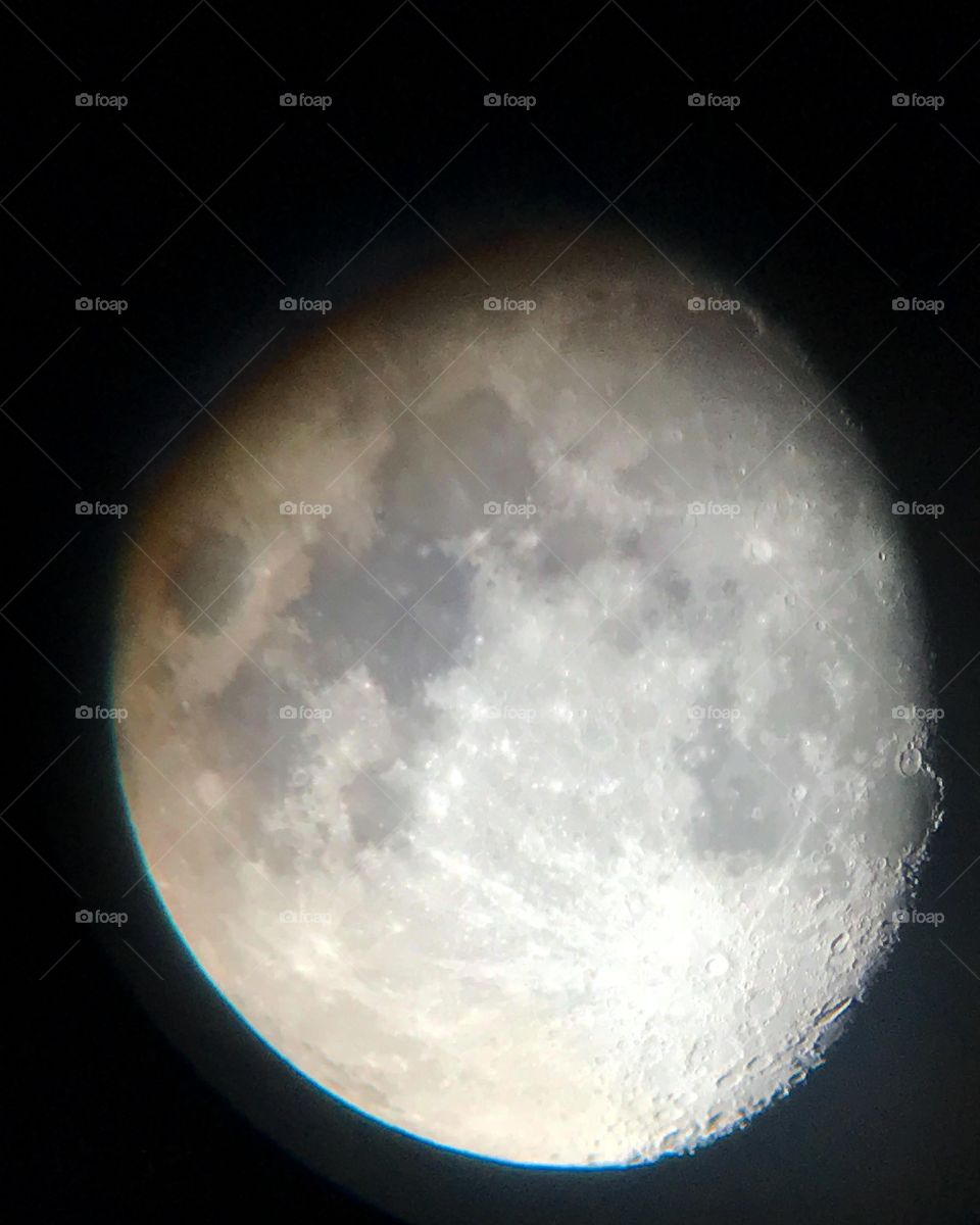The moon and craters visible through the telescope