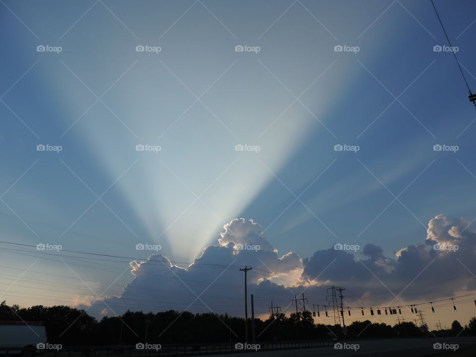 Crepuscular Rays. Intense sunbeams spied over East Syracuse, NY