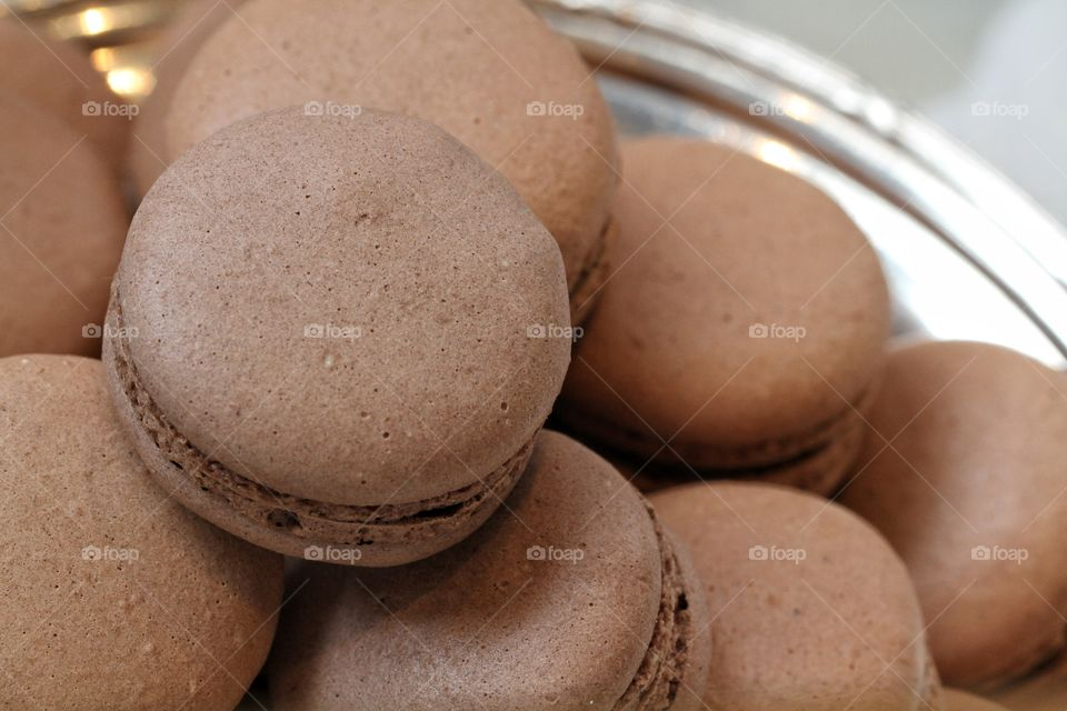 Brown macaroons in the plate