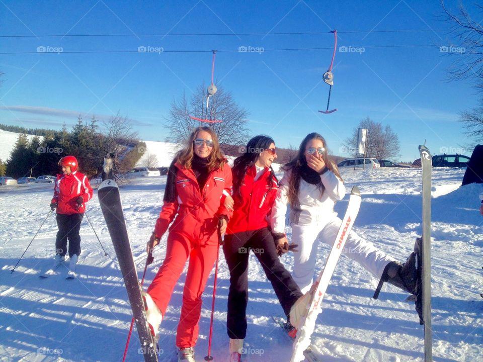 Friends enjoying skiing