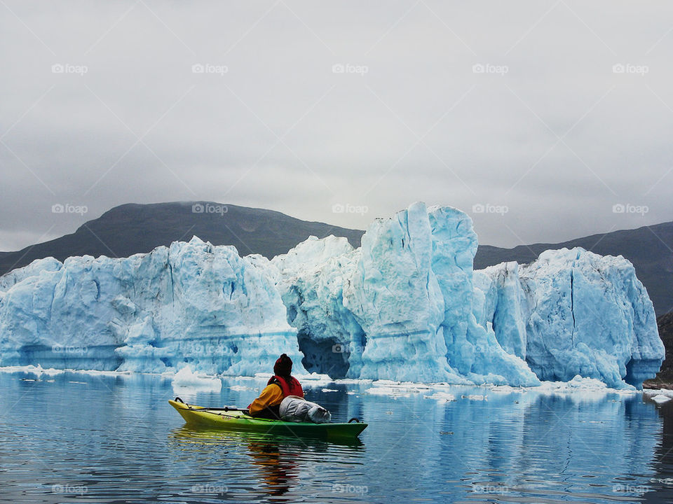 Person on boat looking at glacier