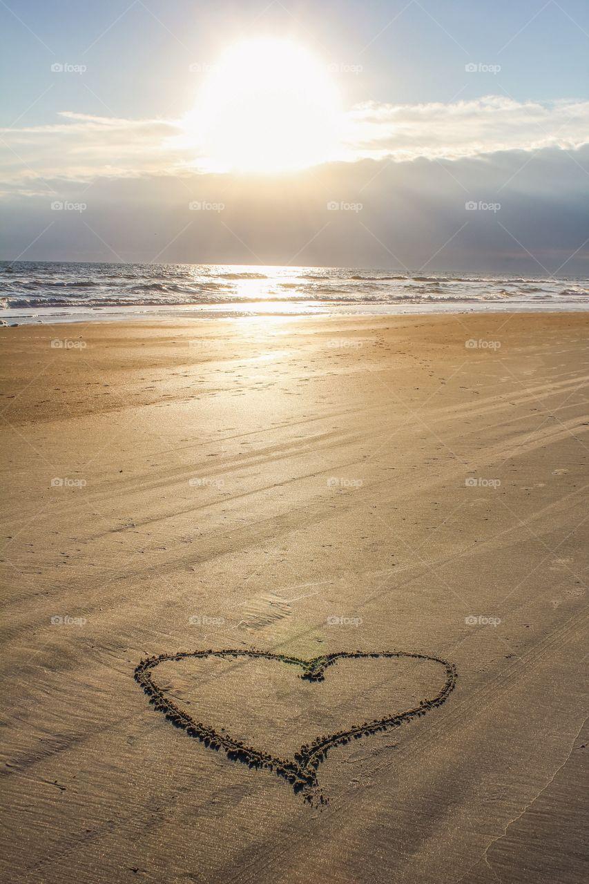 Harte shape on sandy beach