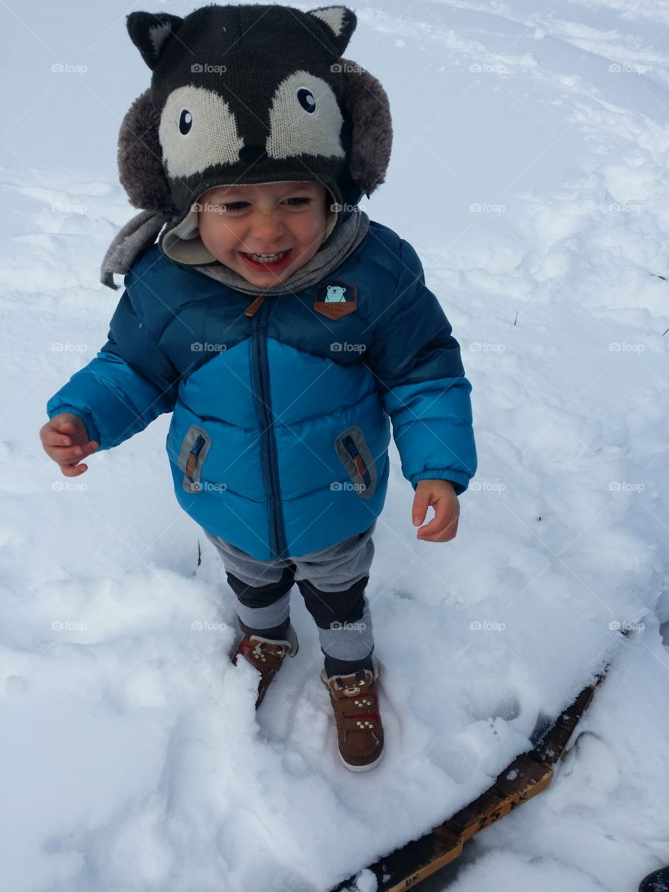 High angle view of baby boy standing in snow